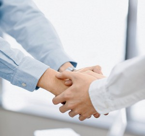 Businessmen Shaking Hands --- Image by © Bloomimage/Corbis