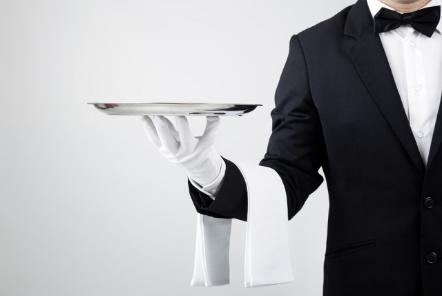 Waiter Serving Dish